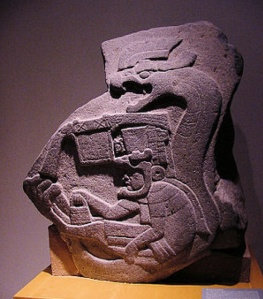 Olmec stone carving of snake and  human figure, Villahermosa, Mexico